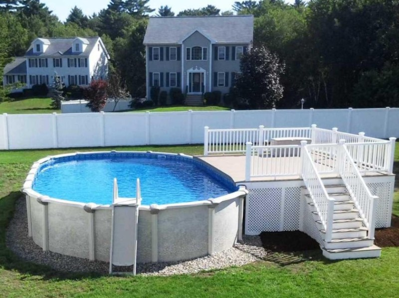 above ground pool deck ideas with pebble stone around pool also vinyl  lattice deck YZMLSYW