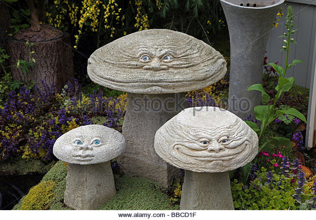 amusing stone mushrooms by david goode as garden ornaments rhs chelsea  flower show 2009 - stock ZRGPEZR