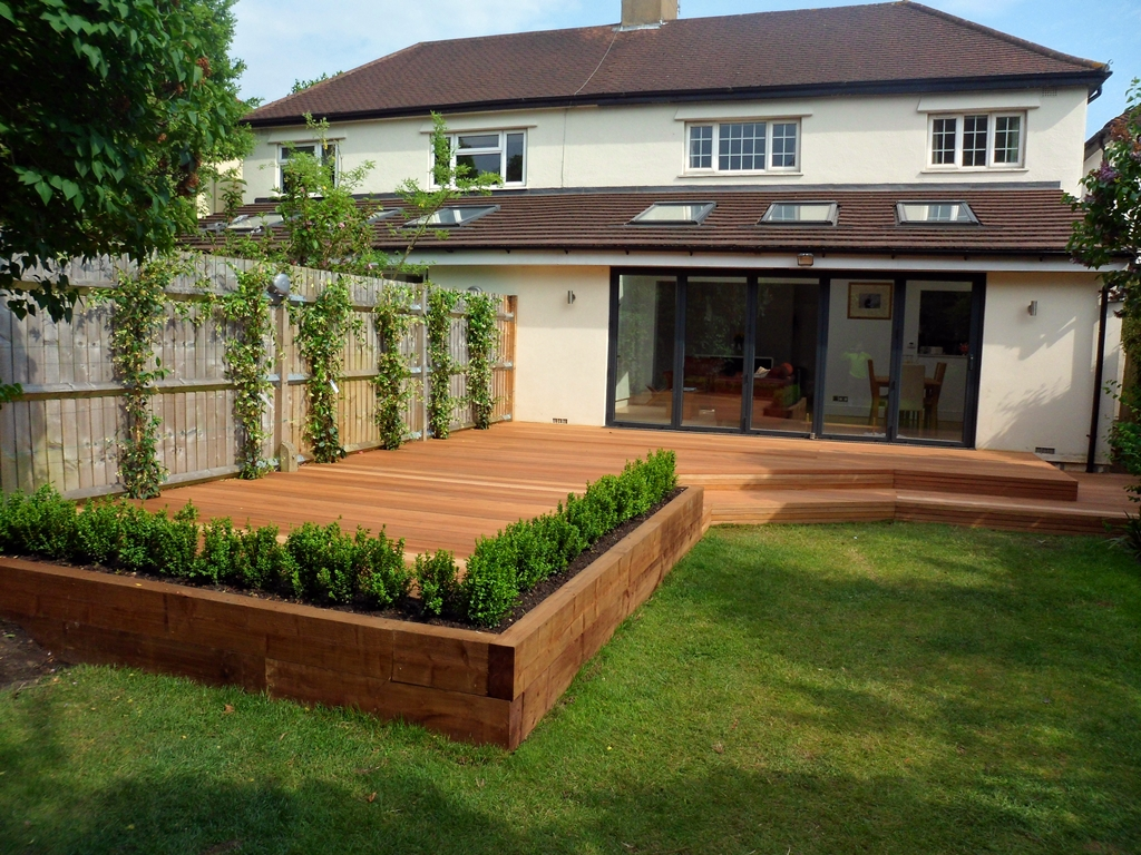 decking ideas hardwood-deck-with-railway-sleepr-raised-bed-and- YTMCWUD