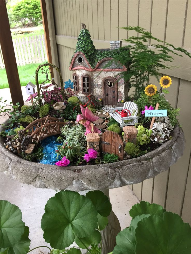 fairy garden. this was a fun project that my granddaughter really enjoyed  helping with. EDEMSYY