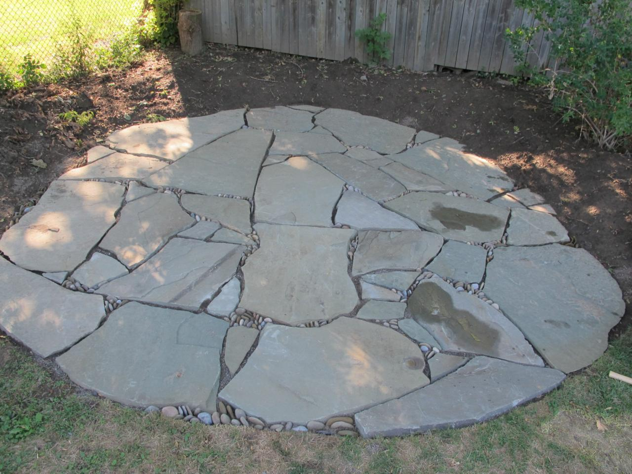 flagstone patio related to: flagstone outdoor spaces patios stone installing BBROSQG