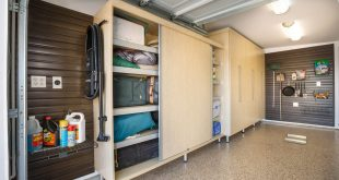 garage storage on another side of the garage is a large-sized rectangular maple melamine  cabinet with YFLINQJ