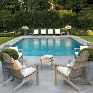 grass, grey stone paving, gorgeous pool furniture and i love the potted  flowers. DQUQVOO