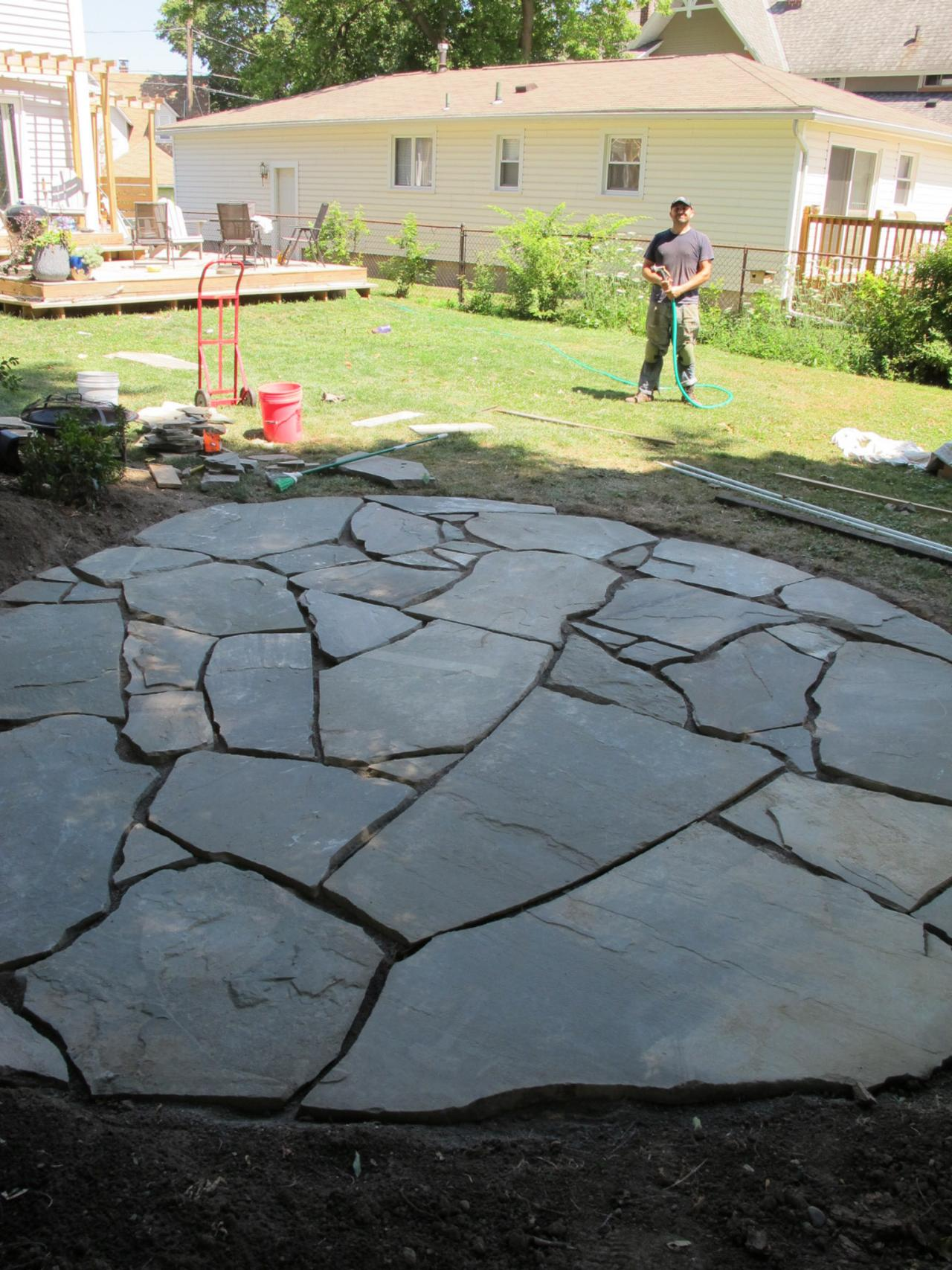 how to install a flagstone patio with irregular stones | diy network blog:  made + remade ZRWOCRZ