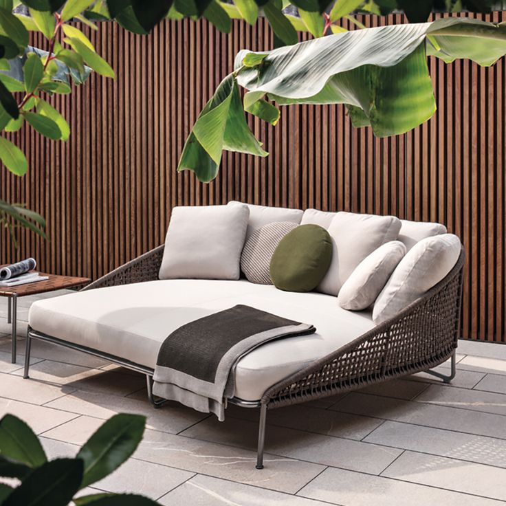 outdoor daybed aston is a family of individual pieces, including a sofa, daybed, armchairs, XRBKGLE