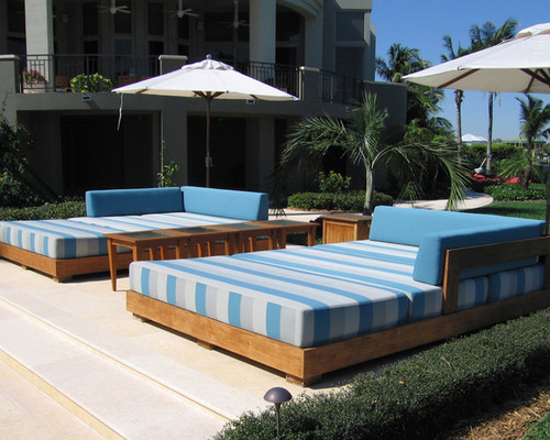 outdoor daybed example of an island style patio design in miami ASQDFKS