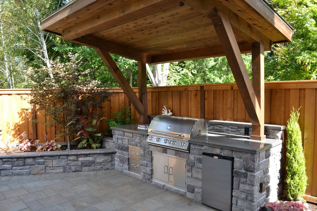 outdoor kitchen ideas rustic patio with polished concrete, outdoor kitchen, raised beds, stacked  stone, fence OSIYRYD