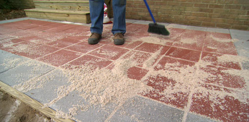 paver patio sweeping sand between pavers. EIQYQEE