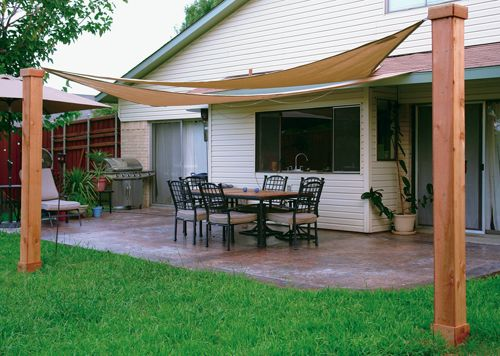 sun shade made in the shade, custom stamped concrete patio with shade sails to  provide protection from FIPWVQW