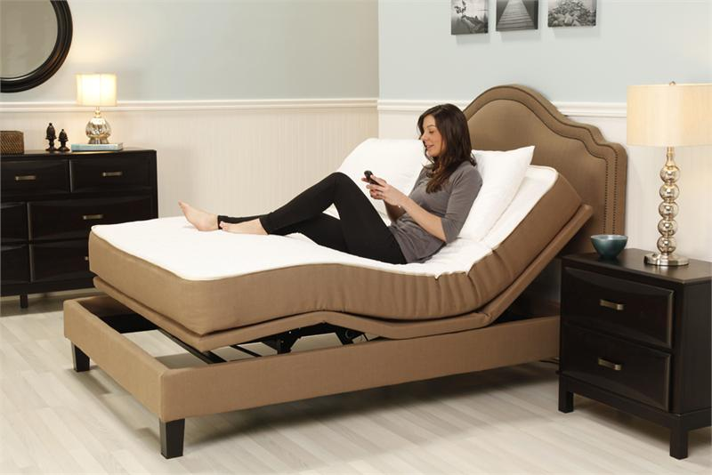 customer enjoying one of our adjustable beds in plainfield, in OMMJFEN