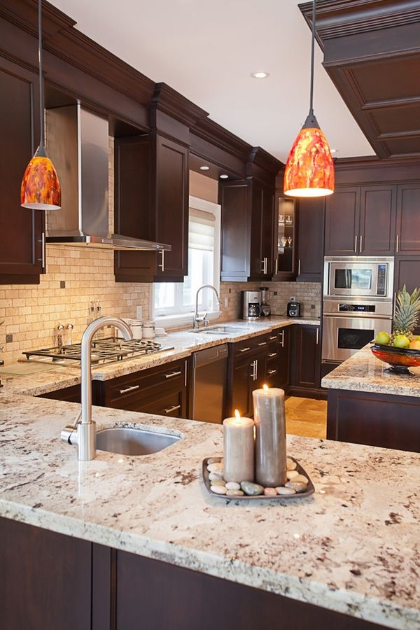 kitchen countertops giallo ornamental granite countertops dark wood cabinets stainless steel  appliances - sleek CBLNMPO