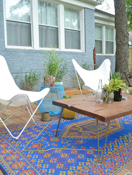 outdoor carpet eclectic patio idea in dallas with brick pavers QMOQBWX