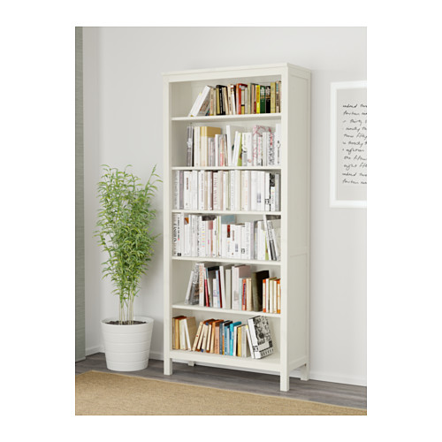 Fast access to books through white bookcase