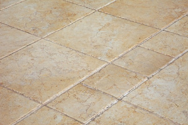 a tan colored ceramic tile floor. KDNTWXF