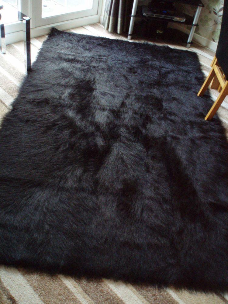 black rugs u0027special offeru0027 large black faux sheepskin shaggy fluffy rug 150 x 240cms OSAAMLM