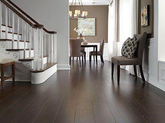 dark wood laminate flooring dark laminate flooring wrapped around this staircase. RDPTRLY