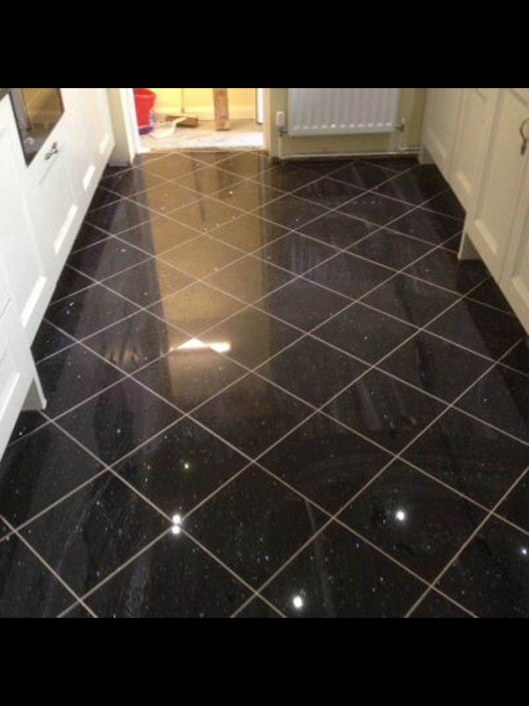 granite floor granite-bathroom floor- very hard stone containing granules and crystals of  mica, quartz NYWRSTZ