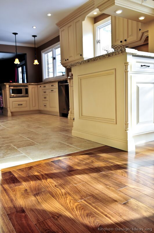 kitchen tile flooring #kitchen idea of the day: perfectly smooth transition from hardwood flooring  to SDQANOX