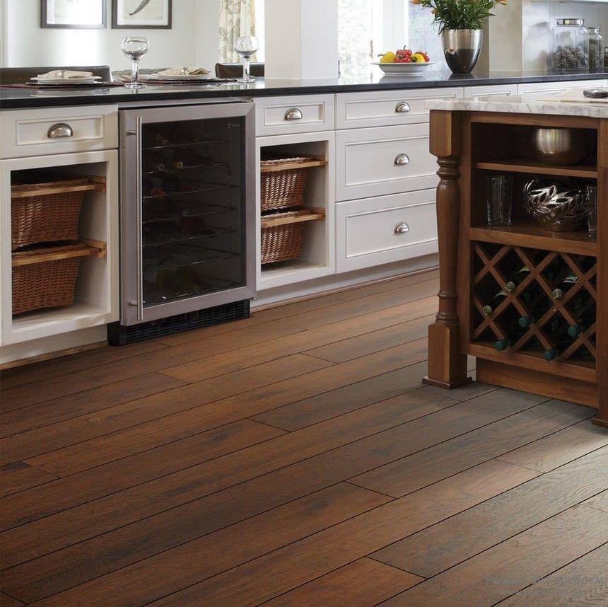 laminate flooring in kitchen the low-down on laminate vs. hardwood floors OVDDXHI