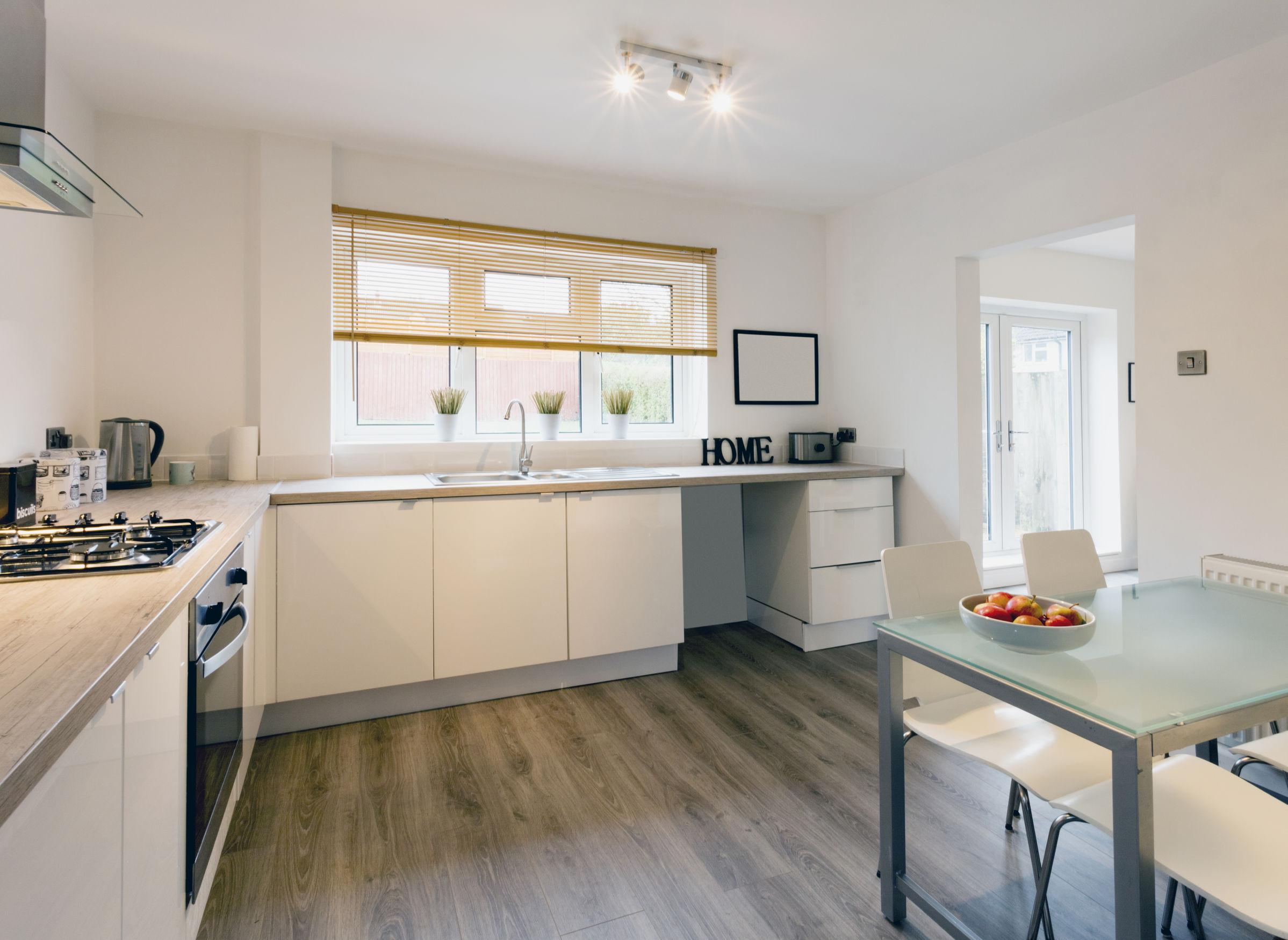 laminate flooring in kitchen top six reasons to select laminate kitchen flooring for your home MMZOCLQ