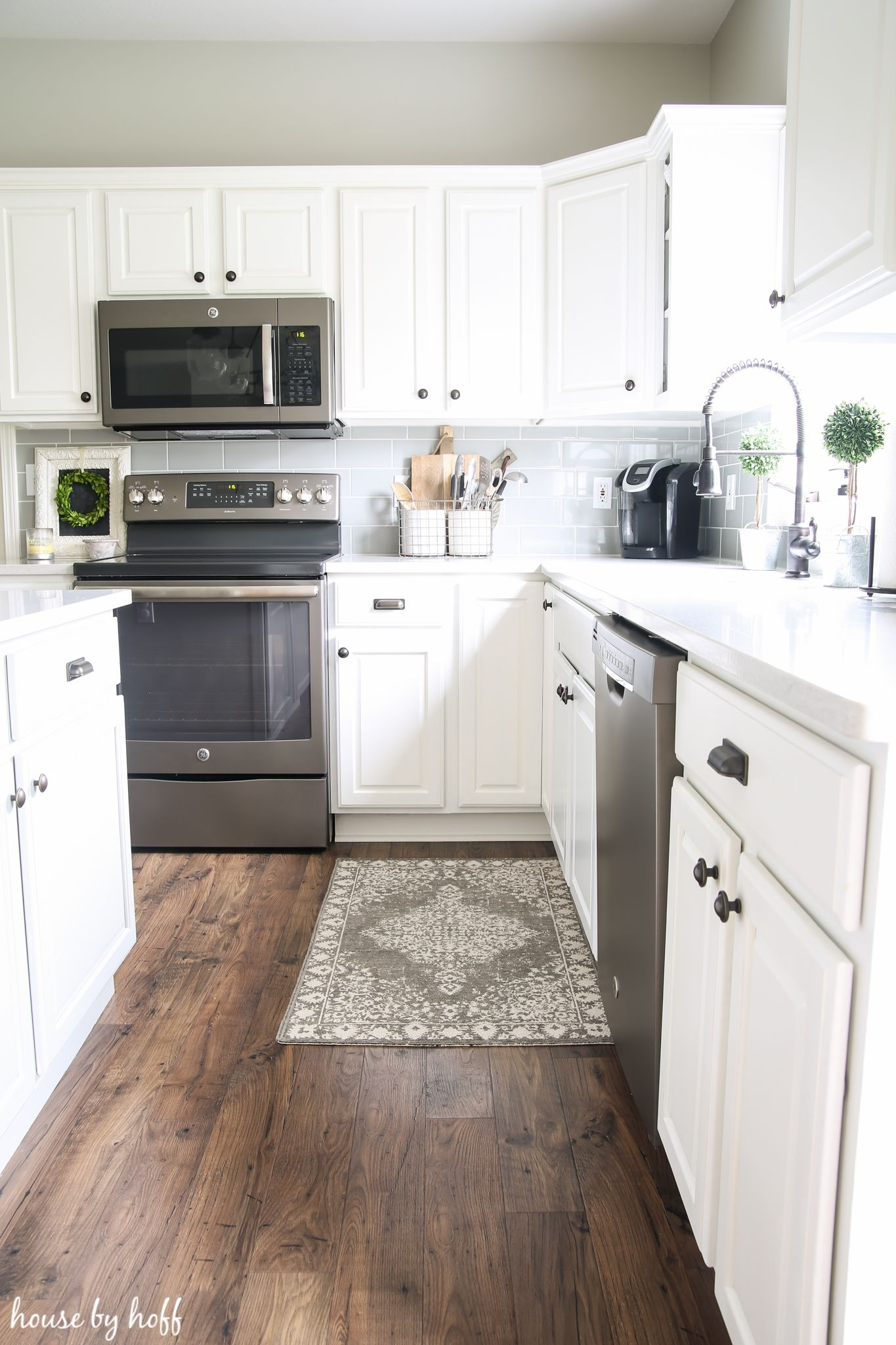 laminate flooring kitchen cabinets how our laminate floors are holding up via house by hoff FRPHSWM