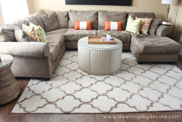 sectional with huge rug. i like the round automan PWDBNSO