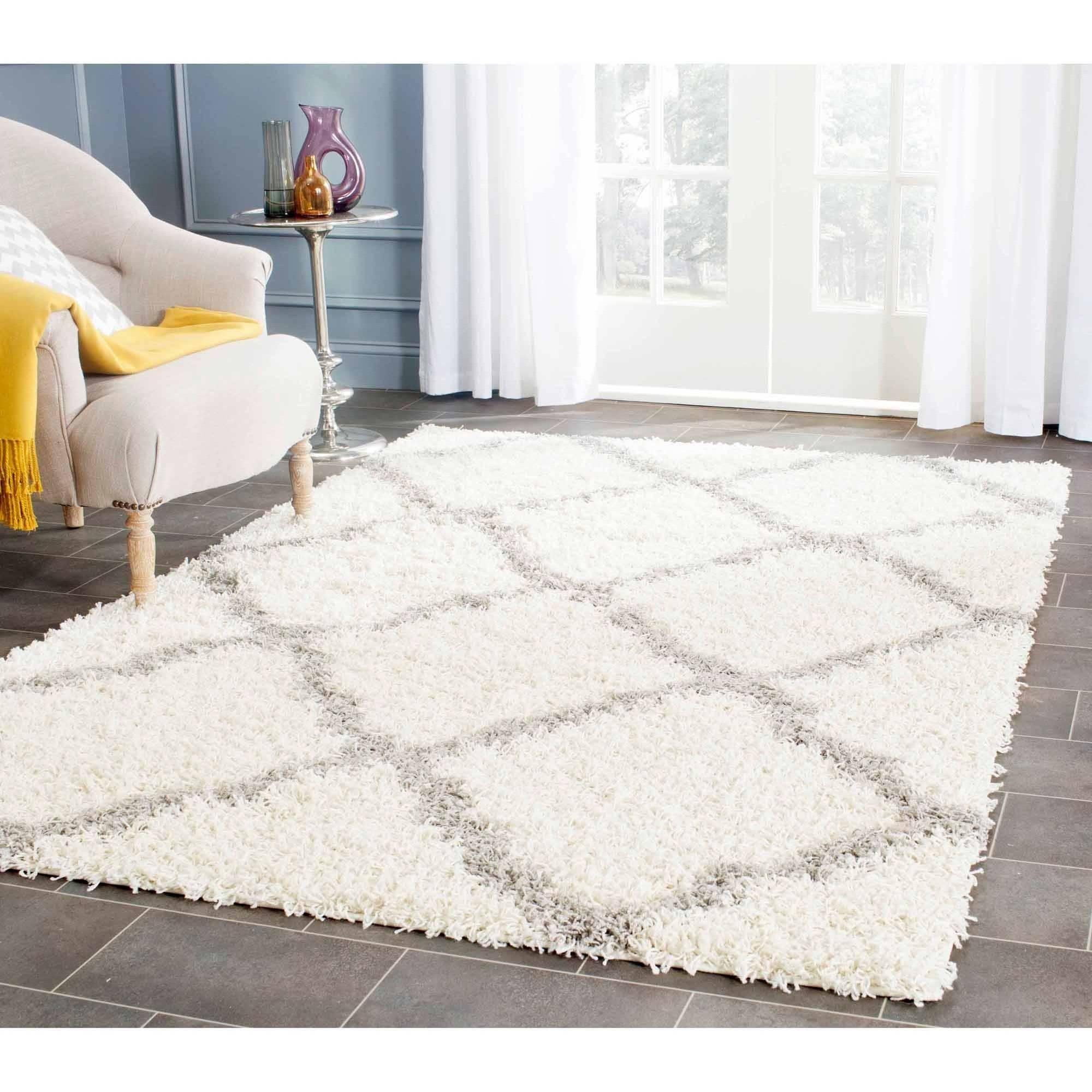 shop the collection. safavieh lavena solid plush shag area rug ... SFSLUOS