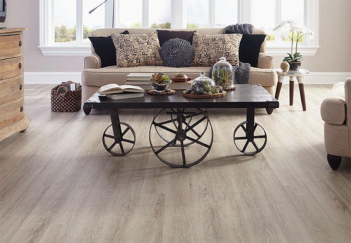 vinyl wood floor light planks of wood-look vinyl flooring in a living room. PUKDUFN