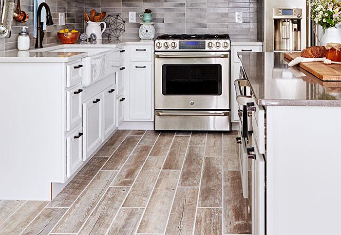 wood tile floors planks of wood-look tile flooring in a kitchen. DQDVJVK
