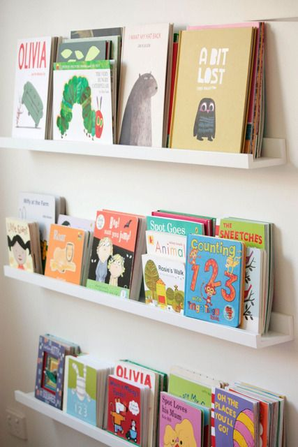 Awesome idea for books in a kid's room. The picture ledges are from