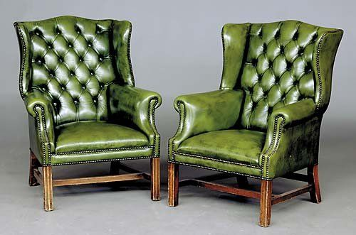 193: Pair Georgian style green leather wingback chairs : Lot 193