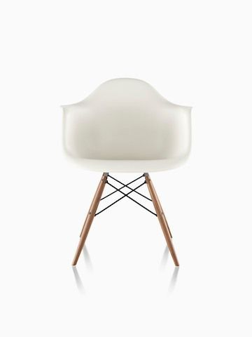 White Eames Molded Plastic armchair with dowel legs, viewed from the