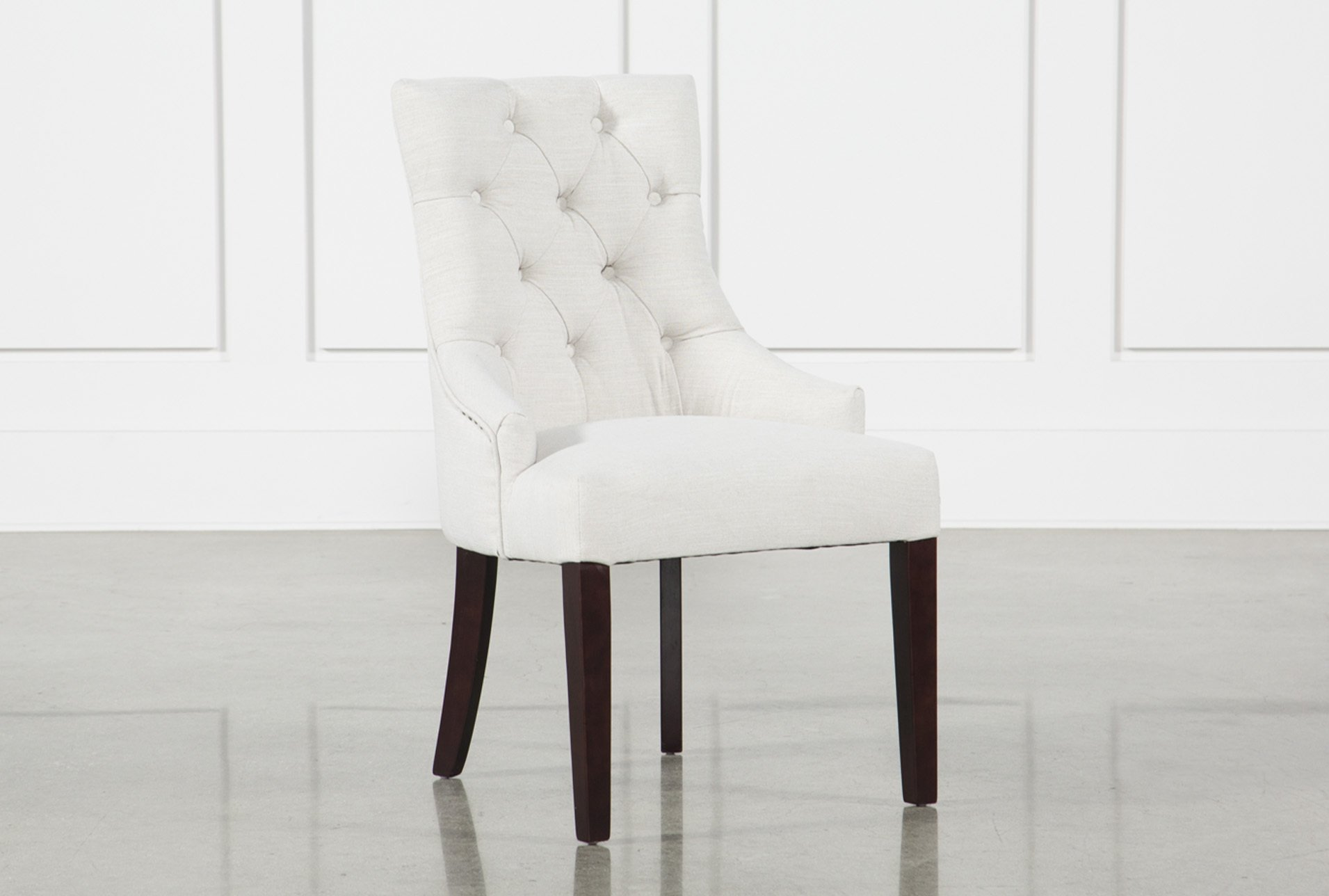 Use a white chair to bring out the class   in your living room