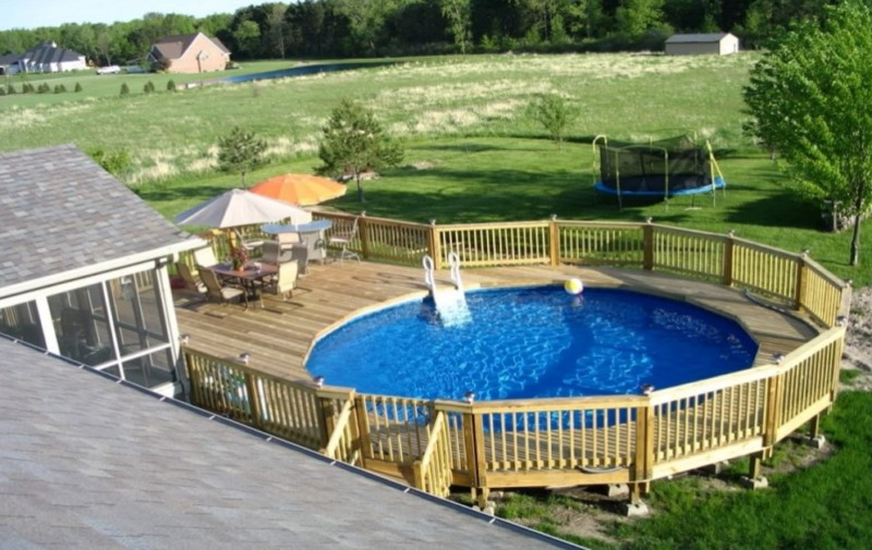 above ground pool deck ideas above ground pool designs with wood railing and table sets VJBPYRP