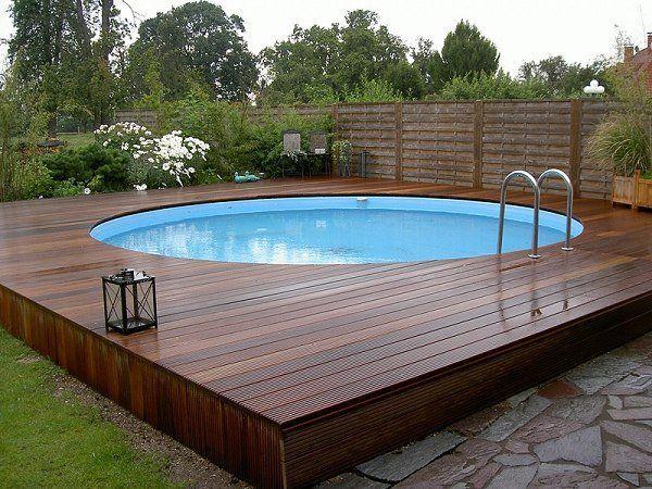above ground pool with deck modern above ground pool decks ideas wooden deck round pool lawn stone slabs LXZLKOD