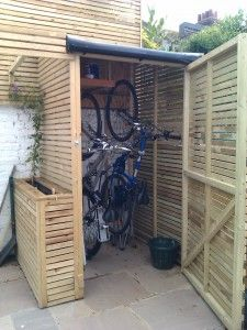 bike storage shed taller, narrower shed to store bikes upright - takes up less room in the HCJITYS