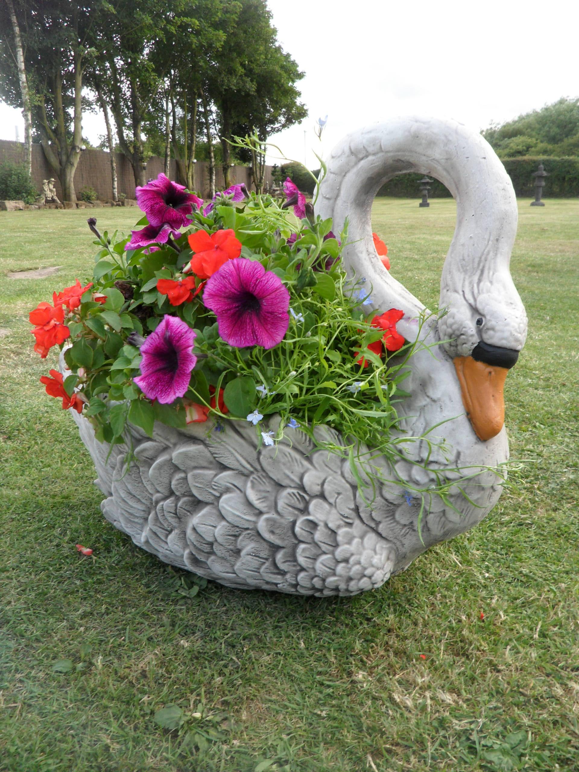 garden ornaments a 60s planter swan in full bloom RUAXSLA