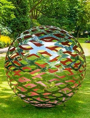 garden sculptures modern garden sphere made from a lattice of stainless steel with a coloured  interior KEUKDVO
