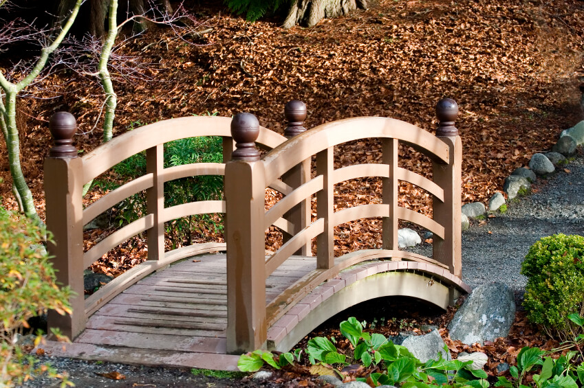 this is an example of a small garden bridge in wood. rather than bridging  the UEMFRSA