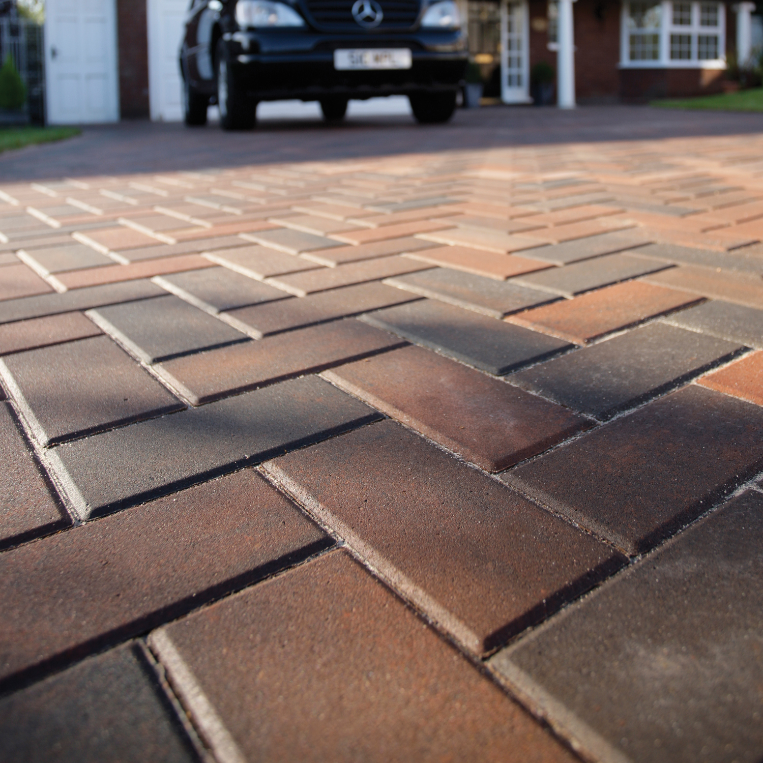 this smart contemporary driveway has been created using multi-colour brett  omega 60mmx200x100mm block paving OUEEMWY