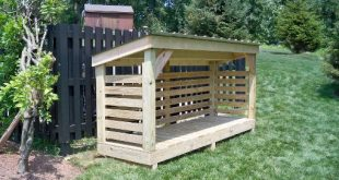 using a wood shed for storing firewood XZHTRPM