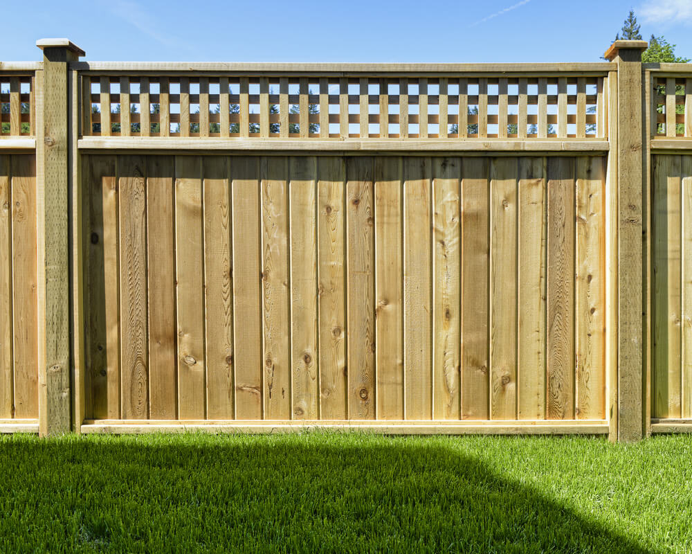 we love beautiful cedar fence designs. this one mixed with panels and  lattice work is FHJZIQQ