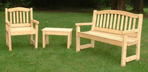 wooden garden furniture cypress bench, chair, and table on lawn GZOSJXZ