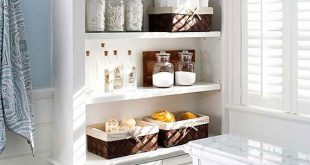 ... large built-in shelving and cabinets for lots of extra bathroom storage OATRMYQ