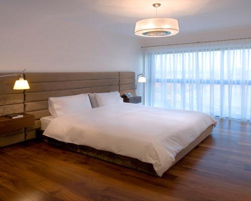bedroom lights trendy bedroom photo in other with medium tone hardwood floors HPVGEEX