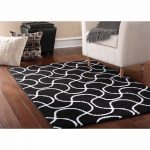 Have classy interior with black and white rug: