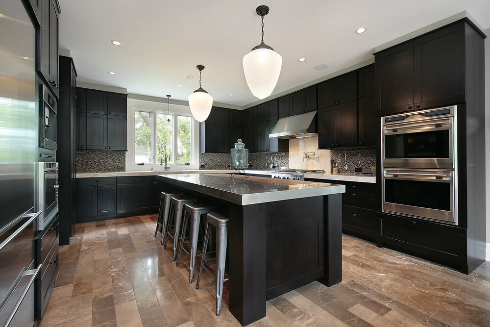 black kitchen cabinets with stainless steel accents QXVHLHI