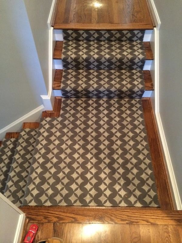 carpet runners typically have a non-slip backing that will also provide  traction KEKNSJD