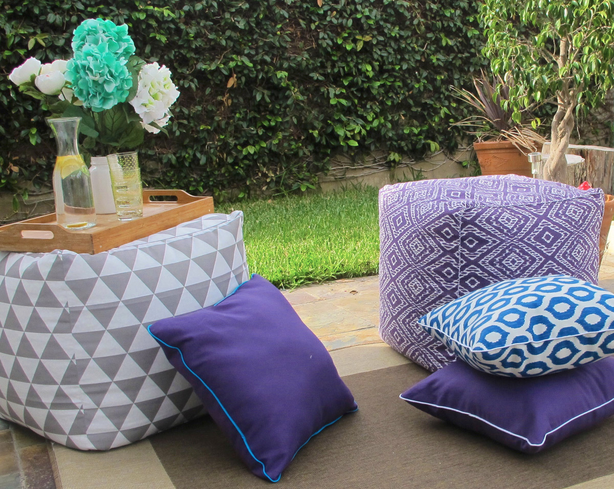 Relaxing outside the house with outdoor pillows