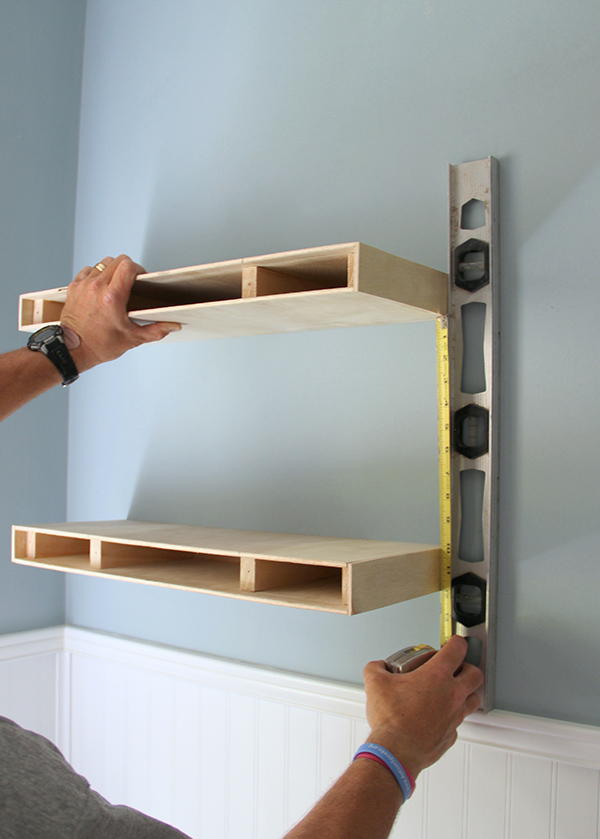 diy shelves measuring for placement of a second floating shelf in a diy floating shelves IFANULR